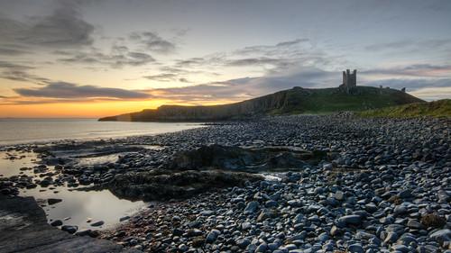 hdr autumn castle seashore tower dunstanburgh dunstan craster northumberland sea pebbles dawn sunrise