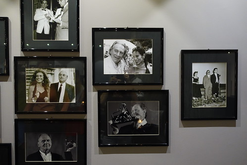 Wall of photos from film festival in bar. From History Comes Alive at Locarno's Belvedere Hotel