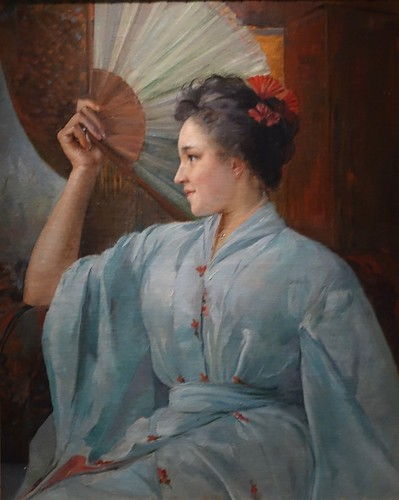 An early 20th-century oil on canvas painting simply signed R.D. of a lady in a kimono holding a fan. From History Comes Alive at Locarno's Belvedere Hotel
