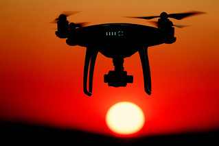Drone flying in the sky at sunset | by wuestenigel