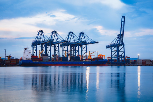 backgrounds businessfinanceandindustry cargocontainer commercialdock concepts containership craneconstructionmachinerydelivering distributionwarehouse freighttransportation globalbusiness nauticalvessel nopeople trading transportationbuildingtypeofbuilding blue business carrying container copyspace dusk environment equipment harbor heavy industry large loading pier refinery sea ship shipping shipyard sunset technology thailand transportation truck unloading warehouse water siracha chonburi crane construction machinery delivering