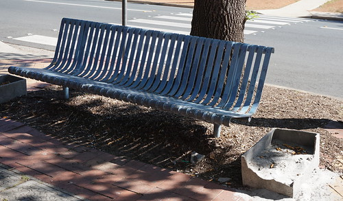 bench with cigarette butts