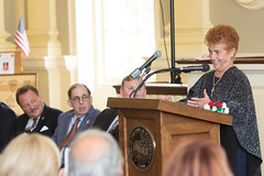 Rep. D'Amelio listens as Waterbury Italian Mayor for the Day Maria Vigliotti addresses the crowd.