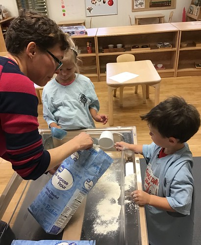 measuring flour for moon sand