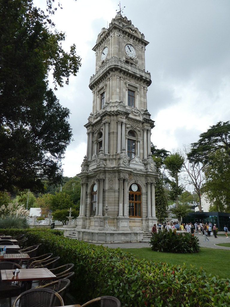 The clock tower in the grounds of the Dolmabahce Palace , Istanbul