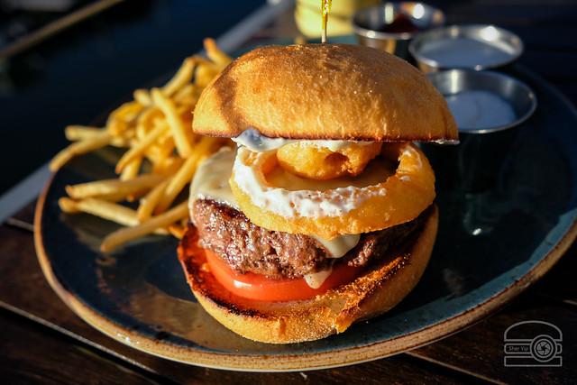 Burger w/ tomato, swiss, onion rings, horseradish cream cheese - Table 9
