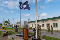 Seabees assigned to NMCB 5 raise the battalion colors during a relief in place, transfer of authority (RIP/TOA) ceremony in Okinawa, Oct. 15. (U.S. Navy/MCC Matthew R. White)