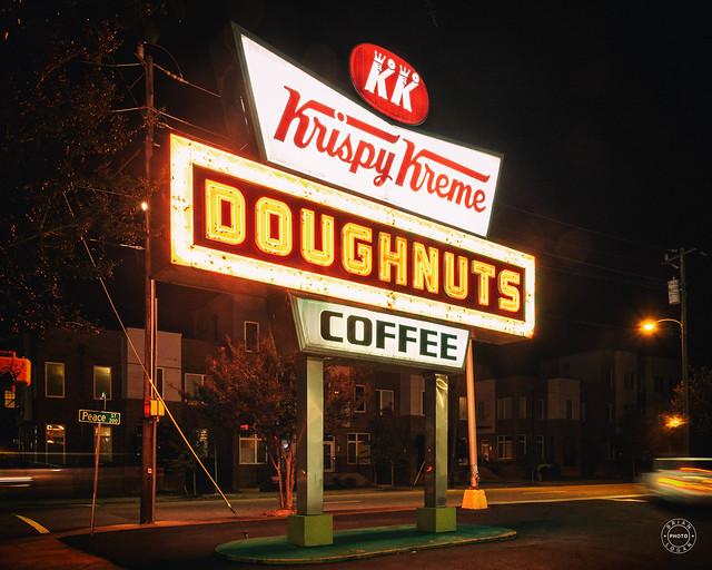 The iconic neon Krispy Kreme Sign at night.