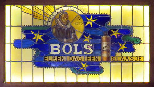 Stained-glass windows advertising Bols Liquor in Cafe Chris in Amsterdam