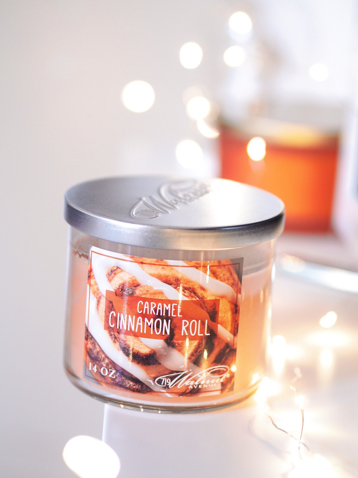 autumnal candles cinnamon roll