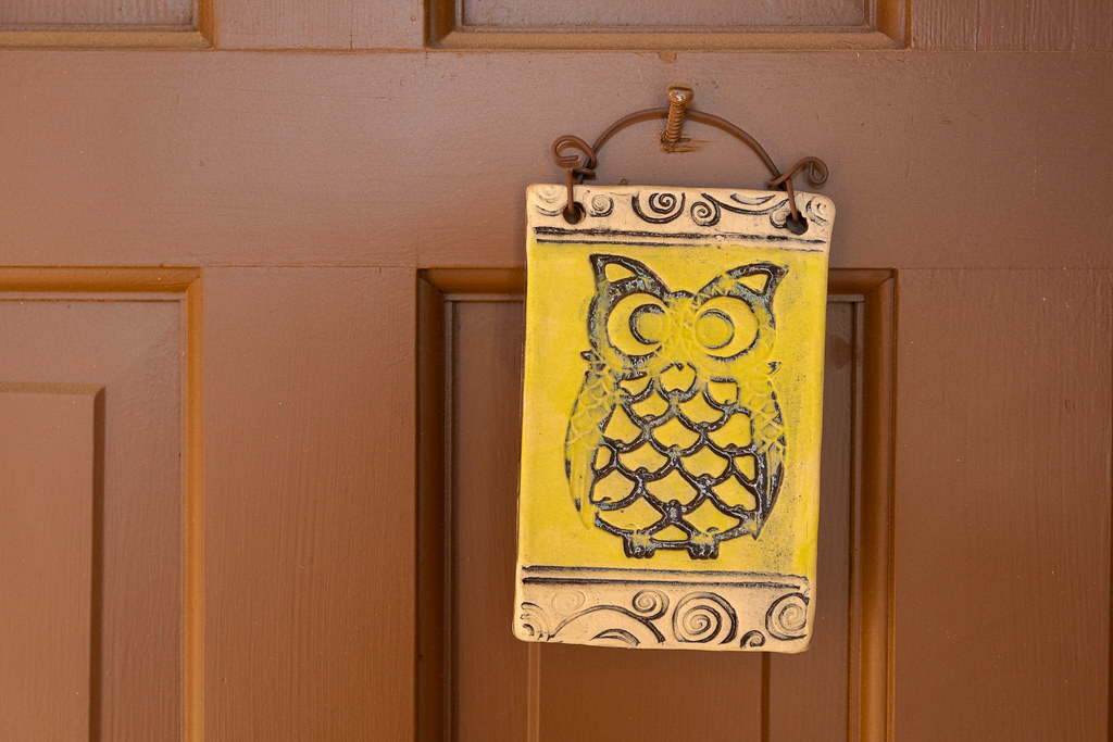 A piece of owl artwork hangs on the door of our rental house in the Buenavante neighborhood of Scottsdale, Arizona in November 2018