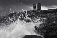 Crashing ashore.