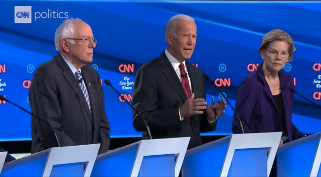 screen shot of Sander, Warren and Biden at the Dem debate