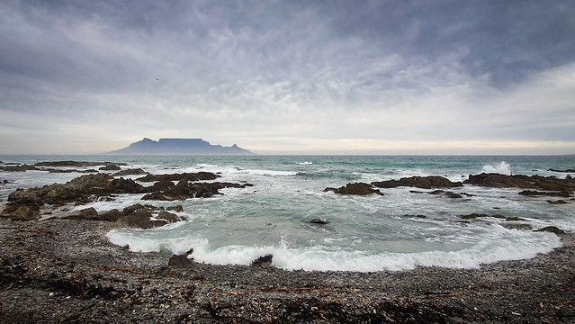 Table Mountain at sunset, from across the bay in Bloubergstrand, Cape Town.