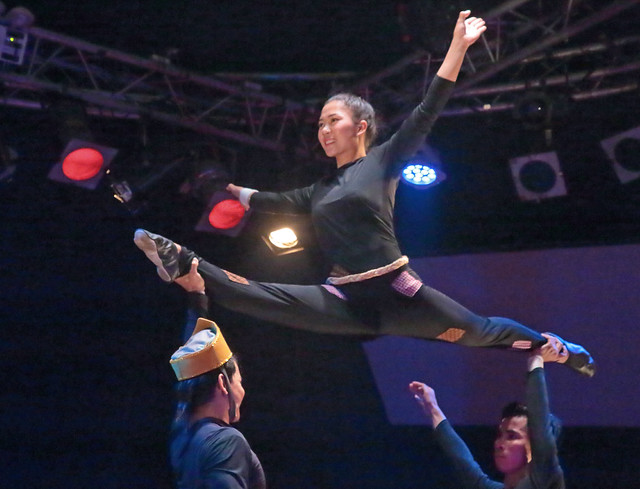 The Acrobat Held High
