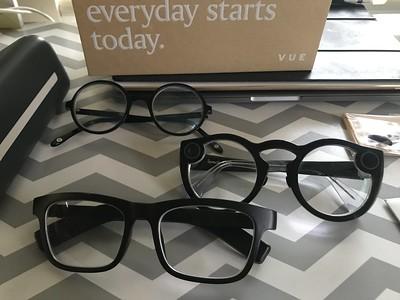 three pairs of glasses