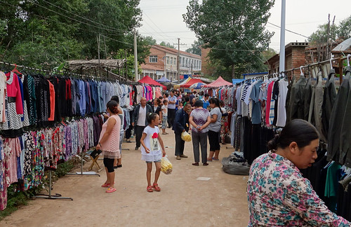 Clothing for sale at market during temple fair, rural Changzhi, Shanxi