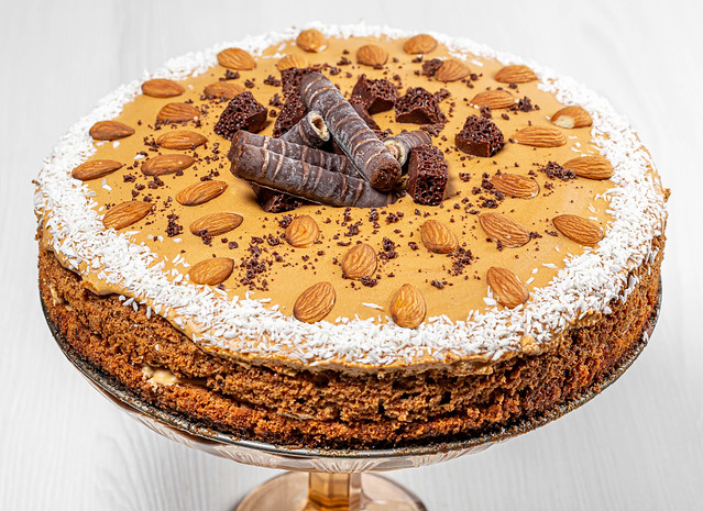 Homemade cake with condensed milk, chocolate, coconut and almonds