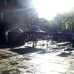 Sunshine on the damp Flag Market at Preston