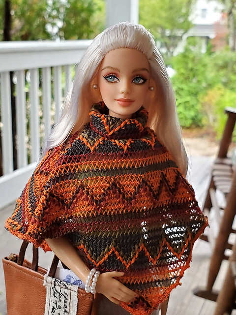 I know it's silly, but I love how her arm shows through the poncho on the right.