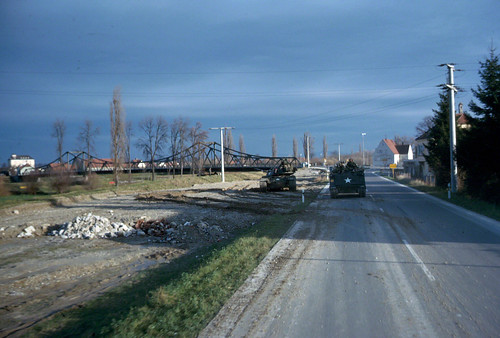 1963 M48A2 and M113 APC by a bridge position  Bavaria. Germany