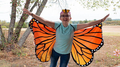 Photo of girl dressed as a monarch butterfly