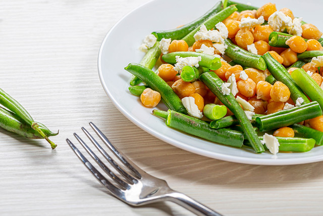 Close up chickpeas with asparagus beans and feta cheese