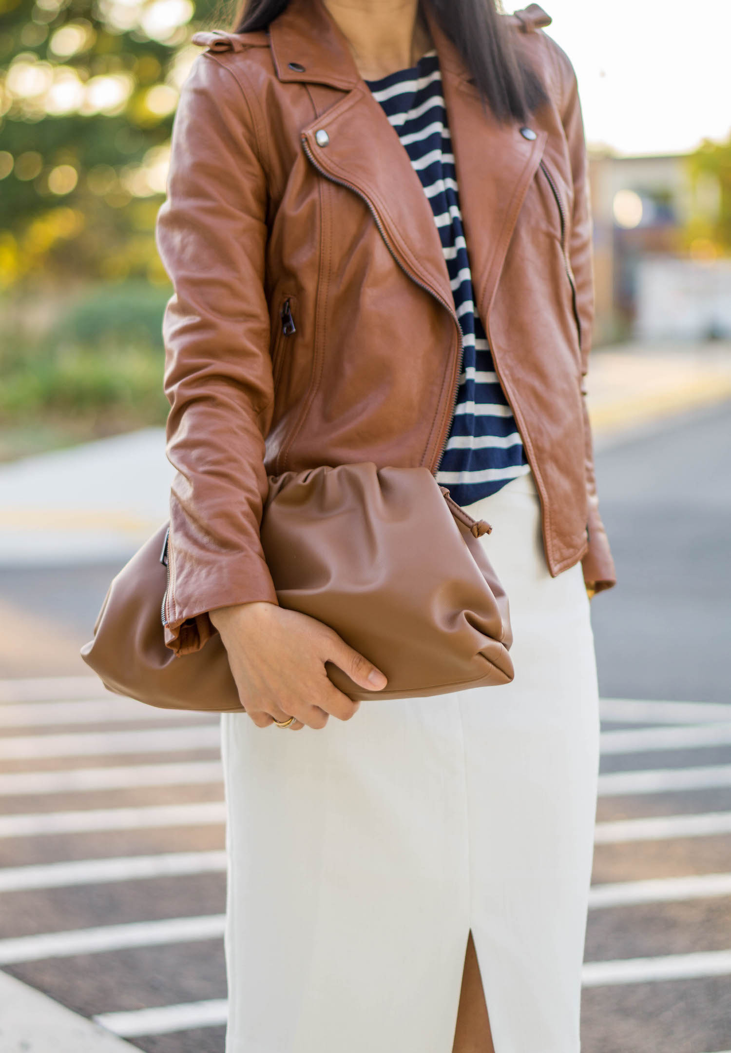 Banana Republic caramel leather moto jacket, J.Crew navy striped top, Looks Like Summer Claudette leather crossbody bag, Ann Taylor white front slit pencil skirt