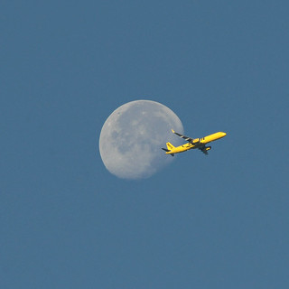 Airlines Passing Moon