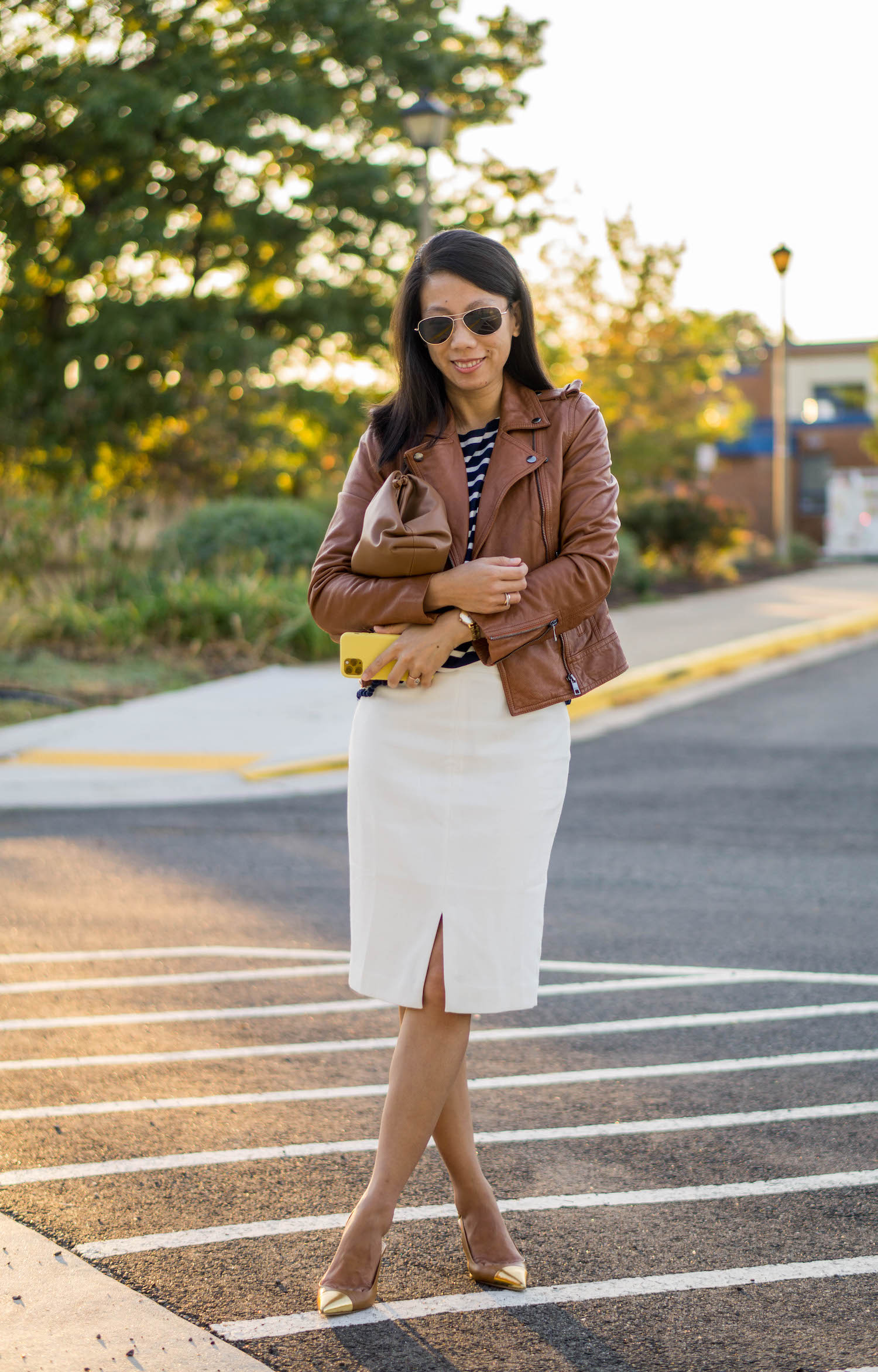Banana Republic caramel leather moto jacket, J.Crew navy striped top, Looks Like Summer Claudette leather crossbody bag, Ann Taylor white front slit pencil skirt, Tory Burch Penelope metallic cap-toe slingback pump