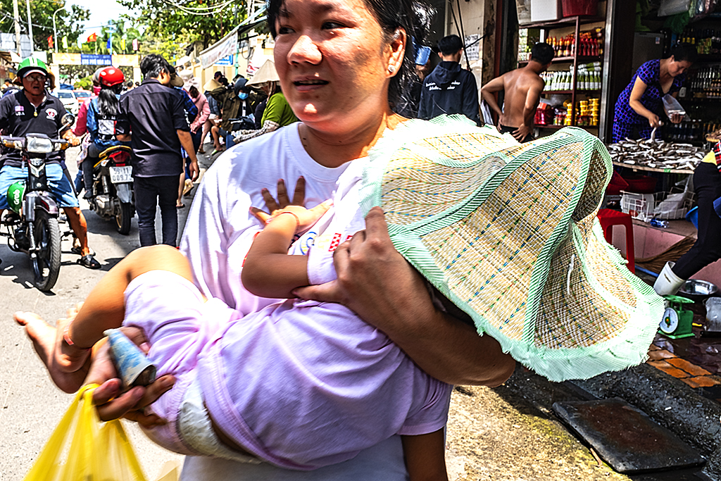Woman carrying child--Vung Tau