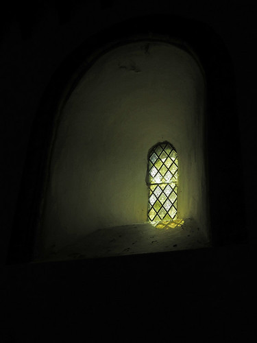 A very simple stained-glass window in Penmon Church in Beaumaris, Wales