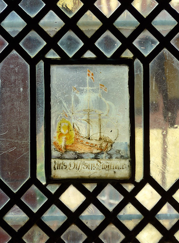 Leaded-glass window with a three-masted schooner painted on the middle inset; in the oldest part of Den Gamle By, a series of historical recreated Danish villages in Aarhus, Denmark
