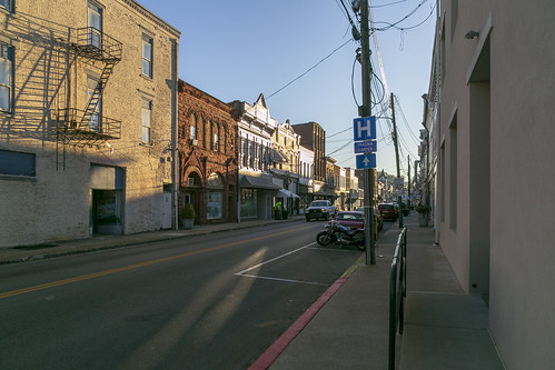 buildings structures historic commercial downtown cynthiana kentucky harrisoncounty twostory sidewalk street cars storefronts awnings streetscape