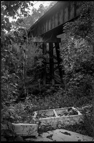 mattresses railroadbridge underthebridge emmaroad asheville northcarolina minoltaxgm superalbinon28mmf28 primelens rolleisuperpan200 hc110developer 35mm 35mmfilm film monochrome monochromatic blackandwhite urbandecay urbanlandscape