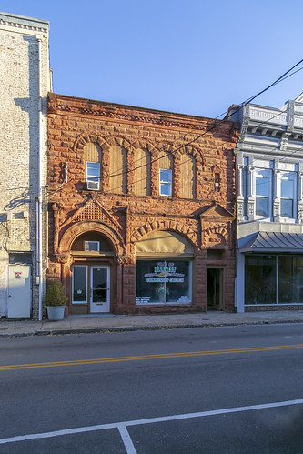 building structure historic commercial twostory 1897 romanesque rusticated stone stonework roundarched altered remodeled sidewalk street cables wires richardsonian storefront cynthiana kentucky harrisoncounty