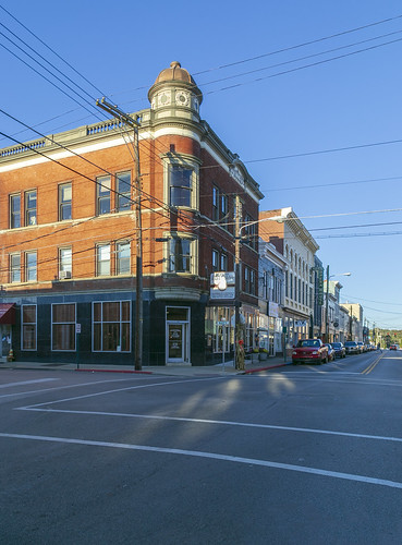 buildings structures building structure historic commercial threestory brick classicalrevival neoclassical entablature dentils balustrade storefronts altered turret 11windows cables wires cynthiana kentucky harrisoncounty