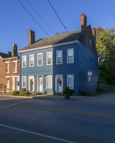 house dwelling residence historic beall twostory brick early federal flemishbond painted blue chimneys flush parapetedgables kneelers jackarched 99windows fluting fluted trim cornerblocks sidewalk street cables wires cynthiana kentucky harrisoncounty