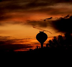 Water Tower Silhouette in the Bright Orange Sunrise