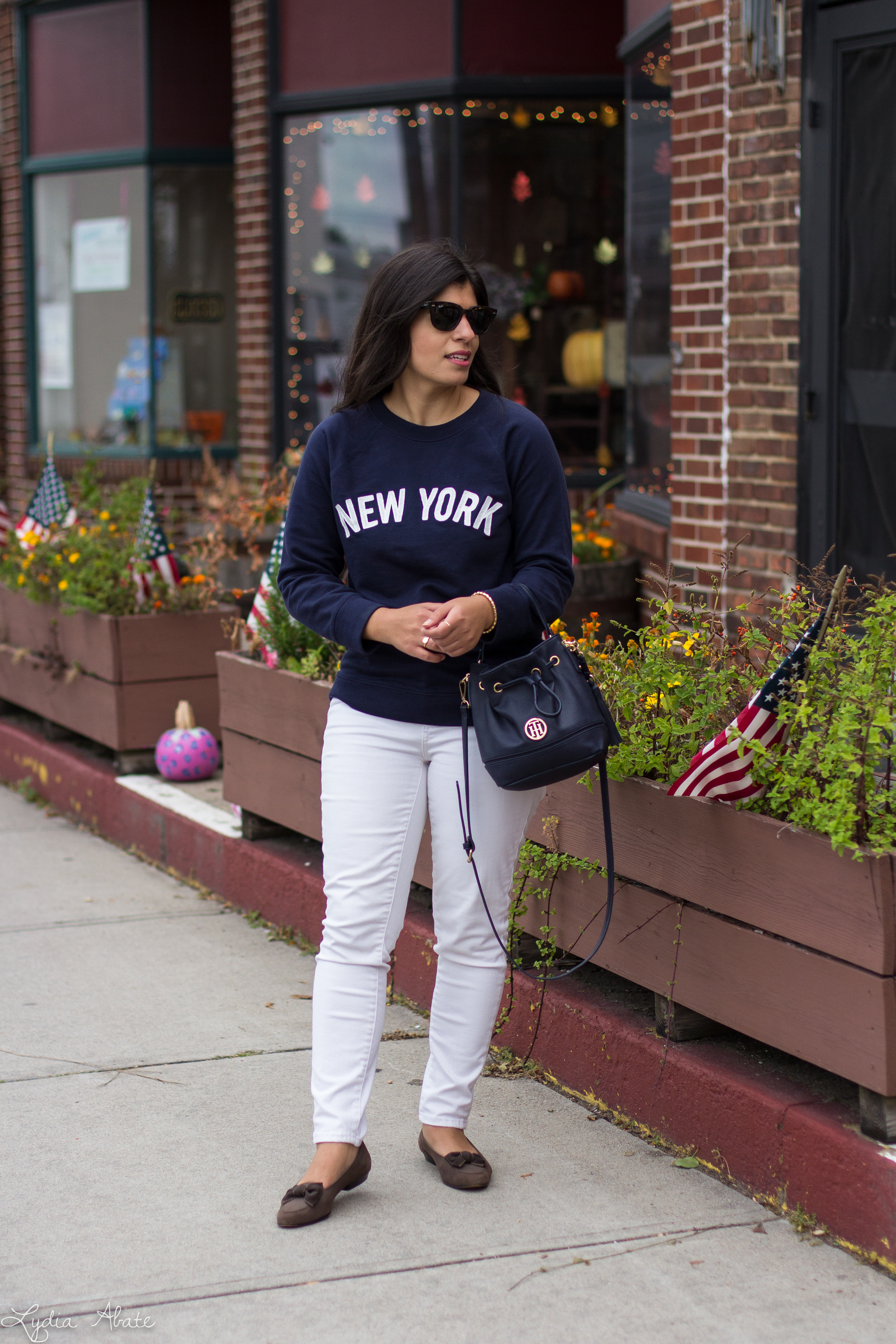 New York sweatshirt, white jeans, navy bucket bag, brown loafers-3.jpg