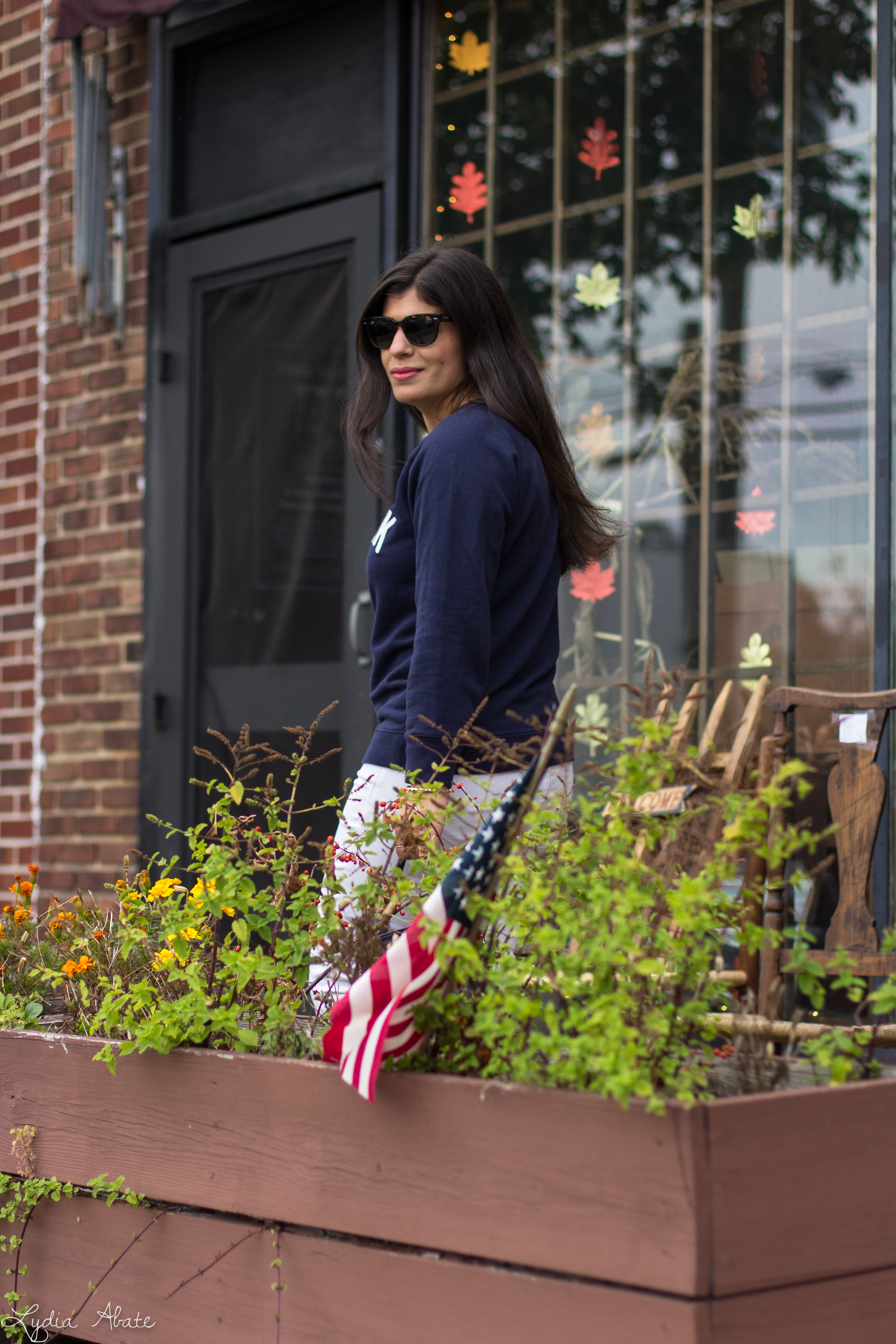 New York sweatshirt, white jeans, navy bucket bag, brown loafers-6.jpg