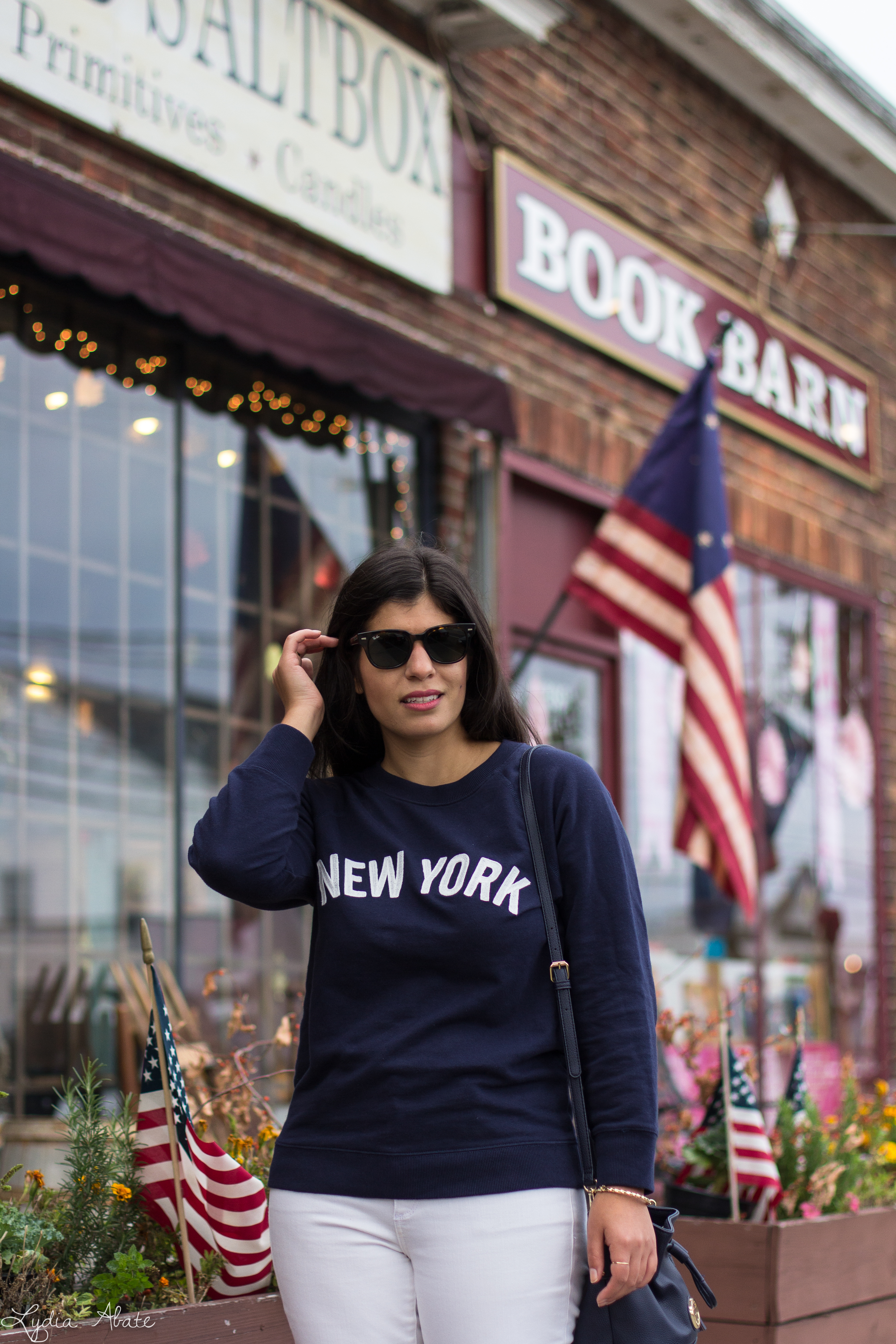 New York sweatshirt, white jeans, navy bucket bag, brown loafers-9.jpg