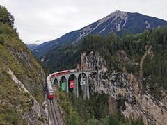Rhb Regio train passing Landwasser Viaduct, Switzerland