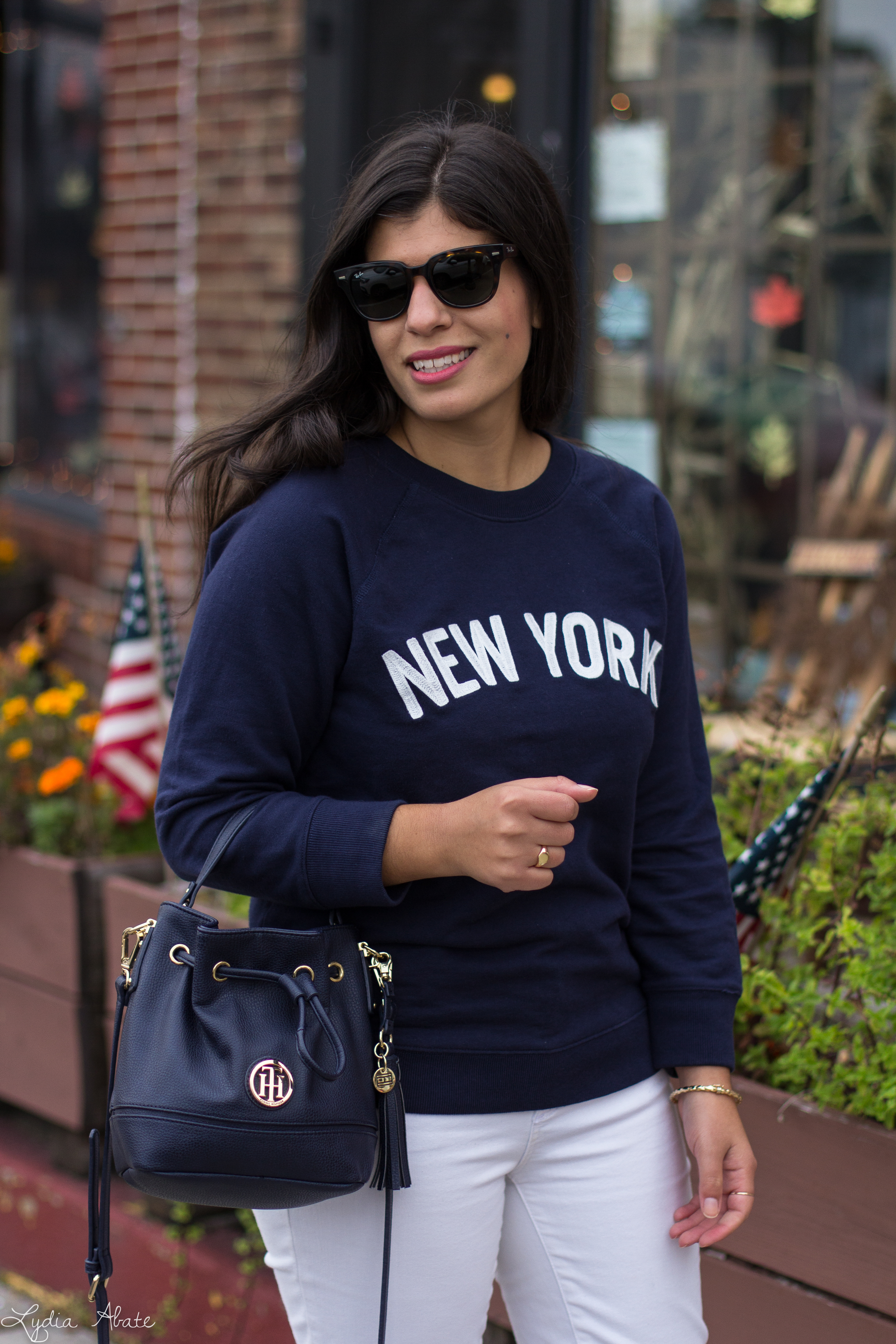 New York sweatshirt, white jeans, navy bucket bag, brown loafers-5.jpg