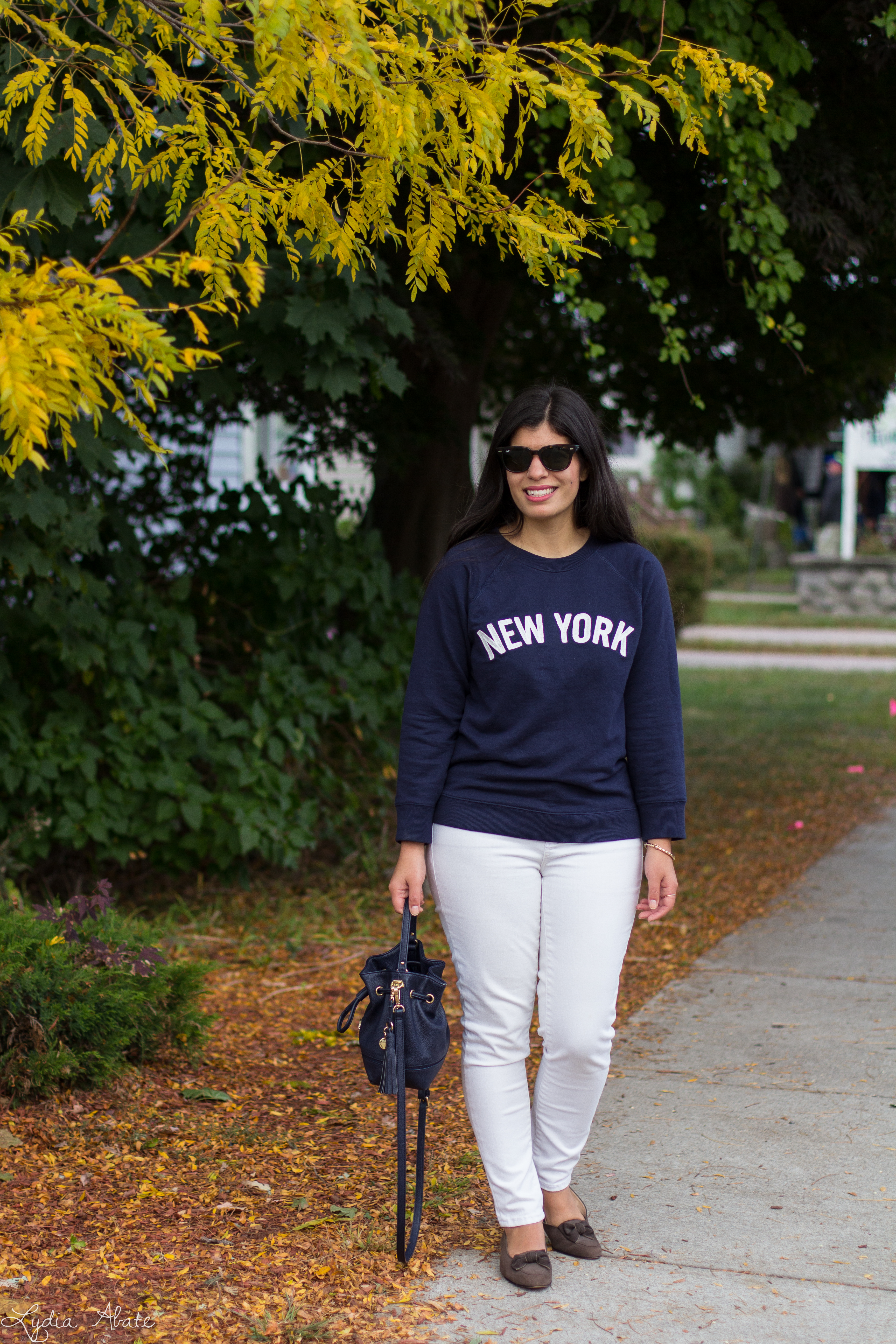 New York sweatshirt, white jeans, navy bucket bag, brown loafers-11.jpg