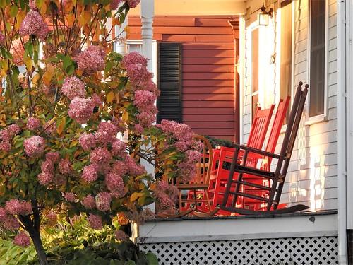 walkingnewengland janelazarz massachusetts fallinnewengland nikonp900 nikon massachusettsautumn autumn porch rockingchairs sunset sunlit red