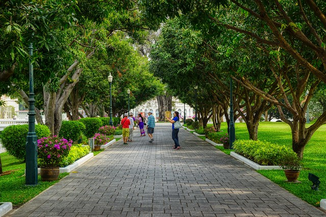 Wide, tree-lined footpath on the grounds of Bang Pa-In palace near Ayutthaya, Thailand