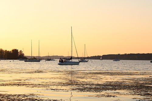 sailboats sunsets lakes muskegonlake muskegon mi michigan parks heritagelanding sunrisesunset sunriseandsunset boats