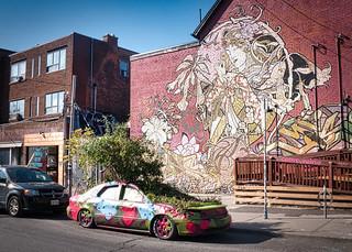 Art looking at car