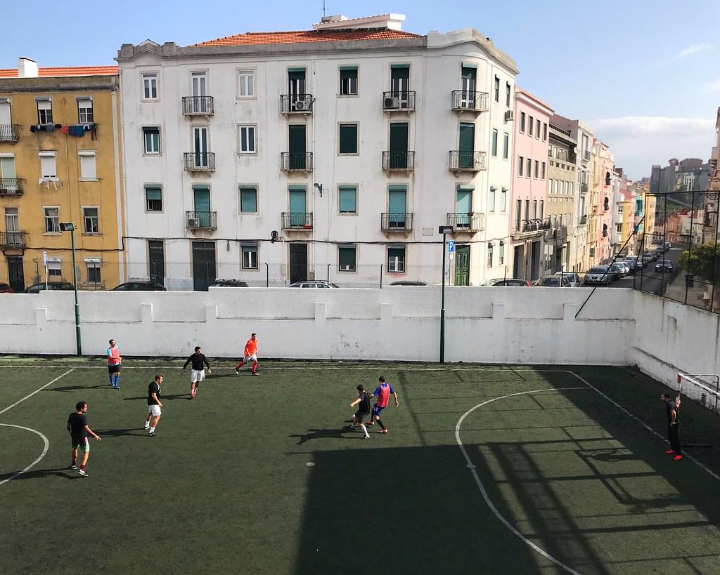 Futbol match in a Lisbon streetside park